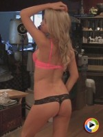 Cute blonde Sherra poses for pictures in a cute pink lace bra and a black thong
